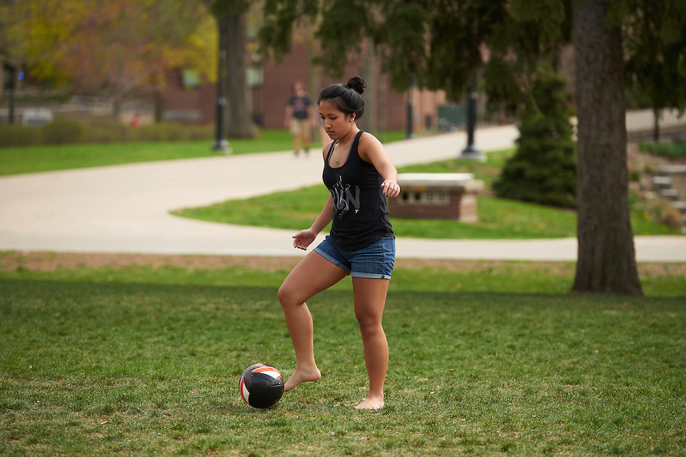 Activity; Playing; soccer ball; Buildings; Eagle Hall; Location; Outside; People; Diversity; Woman Women; Student Students; Spring; April; Time/Weather; cloudy; Type of Photography; Candid; UWL UW-L UW-La Crosse University of Wisconsin-La Crosse