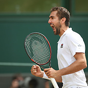 LONDON, ENGLAND - JULY 14: Marin Cilic of Croatia in celebrates a break against Sam Querrey of the United States in the Gentlemen's Singles Semi-final of the Wimbledon Lawn Tennis Championships at the All England Lawn Tennis and Croquet Club at Wimbledon on July 14, 2017 in London, England. (Photo by Tim Clayton/Corbis via Getty Images)