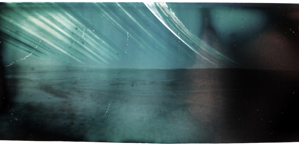 A 6 month long exposure of a viewpoint near Cochrane Alberta. From winter solstice (lowest arc in the sky) till summer solstice (highest arc). Made with a DIY pinhole camera and a piece of photographic paper.