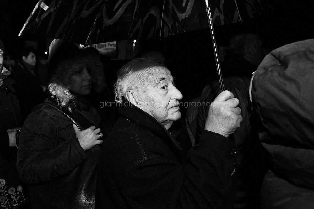 "Caserta, Italy - 22 January 2013:  Comic Beppe Grillo, leader of the 5 Stars Movement in Naples, Italy, on January 22nd 2013.CASERTA, ITALY - 22 JANUARY 2013: Beppe Grillo, a comedian and leader of the 5 Stars Movement (M5S, Movimento 5 Stelle) rallies in Caserta on January 22, 2013. Grillo, whom presents itself as a ""non-politician"", and the 5 Stars Movement as ""not a party"". Grillo has been running a mostly internet-based political campaign through the party's blog and the local groups that have emerged from it. The movement has a strong anti-politics agenda: ""All political parties are crooked and they all need to go"", Grillo says.<br /> <br /> <br /> A general election to determine the 630 members of the Chamber of Deputies and the 315 elective members of the Senate, the two houses of the Italian parliament, will take place on 24–25 February 2013. The main candidates running for Prime Minister are Pierluigi Bersani (leader of the centre-left coalition ""Italy. Common Good""), former PM Mario Monti (leader of the centrist coalition ""With Monti for Italy"") and former PM Silvio Berlusconi (leader of the centre-right coalition).<br /> <br /> ###<br /> <br /> ROMA, ITALIA - 24 GENNAIO 2013: <br /> <br /> a Roma, il 24 gennaio 2013.<br /> <br /> Le elezioni politiche italiane del 2013 per il rinnovo dei due rami del Parlamento italiano – la Camera dei deputati e il Senato della Repubblica – si terranno domenica 24 e lunedì 25 febbraio 2013 a seguito dello scioglimento anticipato delle Camere avvenuto il 22 dicembre 2012, quattro mesi prima della conclusione naturale della XVI Legislatura. I principali candidate per la Presidenza del Consiglio sono Pierluigi Bersani (leader della coalizione di centro-sinistra ""Italia. Bene Comune""), il premier uscente Mario Monti (leader della coalizione di centro ""Con Monti per l'Italia"") e l'ex-premier Silvio Berlusconi (leader della coalizione di centro-destra).CASERTA, ITALY - 22 JANUARY 2013: Beppe Grillo, a comedian and leader of the 5 Stars Movement (M5S, Movimento 5 Stelle) rallies in Cas"