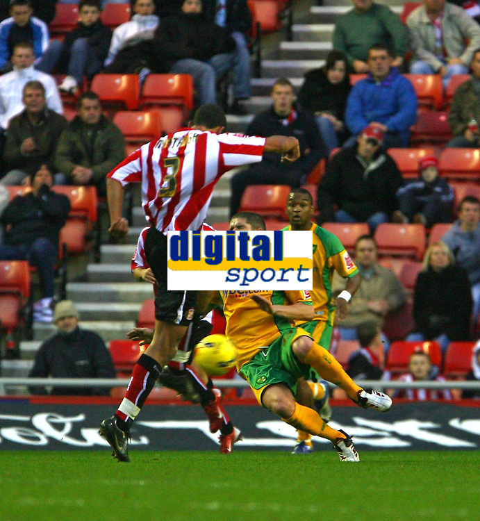 Photo: Andrew Unwin.<br />Sunderland v Norwich City. Coca Cola Championship. 02/12/2006.<br />Norwich's Carl Robinson (R) dives in bravely against his former club as looks to block an attack.