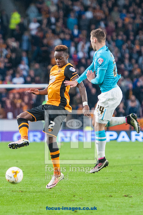 Moses Odubajo of Hull City brings the ball under control ahead of Andreas Weimann of Derby County during the Sky Bet Championship Playoff Semi-final Leg Two at KC Stadium, Hull<br /> Picture by Matt Wilkinson/Focus Images Ltd 07814 960751<br /> 17/05/2016