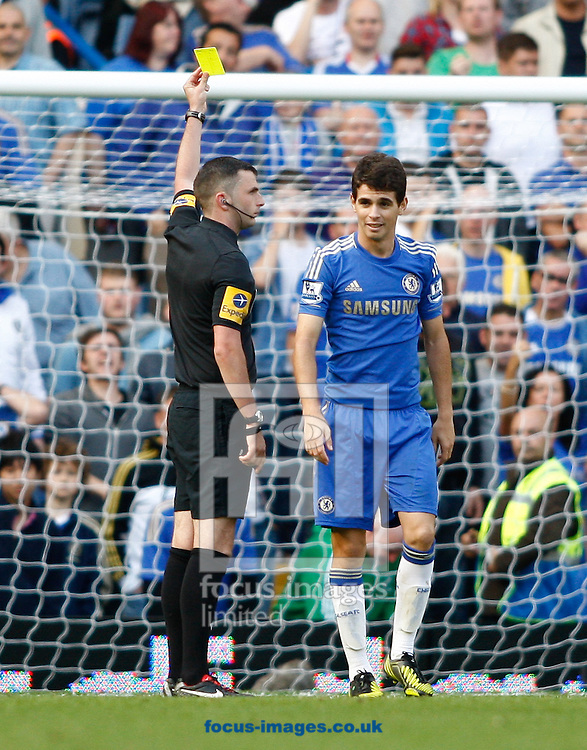 Picture by Andrew Tobin/Focus Images Ltd +44 7710 761829.22/09/2012. Oscar of Chelsea is booked by referee Michael Oliver during the Barclays Premier League match at Stamford Bridge, London.