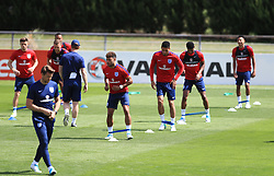 England's Alex Oxlade-Chamberlain and Chris Smalling during the training session at Stade Omnisport.