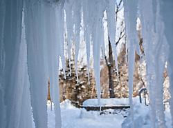 """THEMENBILD - Sibirische Kaelte in Europa, derzeit sorgt das Sibirische Hoch Cooper in Europa fuer Temperaturen jenseits des Gefrierpunktes. In Oesterreich werden Temperaturen bis zu minus 20 Grad erwartet und es gibt schon die ersten Todesfaelle durch die grosse Kaelte in ganz Europa, im Bild durch die tiefen Temperaturen der vergangenen Tage hat sich in der Nähe von Kaprun (Salzburg) eine """"Eiswelt"""" gebildet, riesige Eiszapfen hängen von einer Felsdecke // Siberian cold weather in Europe, currently the Siberian high Cooper makes temperatures beyond zero in Europe. In Austria, temperatures down to minus 20 degrees expected and there is already the first deaths of the great cold weather throughout Europe. By the low temperatures of recent days is formed near Kaprun (Salzburg), an """"ice world"""" huge icicles hanging from a cliff top, EXPA Pictures © 2012, PhotoCredit: EXPA/ Juergen Feichter"""