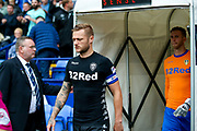 Leeds United defender Liam Cooper (6) leads his team out  during the EFL Sky Bet Championship match between Bolton Wanderers and Leeds United at the Macron Stadium, Bolton, England on 6 August 2017. Photo by Simon Davies.