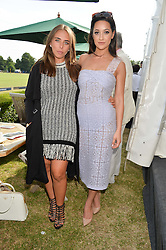 Left to right, CHLOE GREEN and ROXIE NAFOUSI at the Laureus Polo held at Ham Polo Club, Ham, Richmond, Surrey on 18th June 2015.
