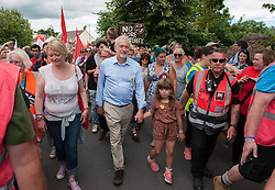 © Licensed to London News Pictures.17/07/2016. Tolpuddle, Dorset, UK. JEREMY CORBYN, Labour leader, attends the Tolpuddle Martyrs trade union festival. Jeremy Corbyn laid a wreath at the martyrs grave in the churchyard, joined the procession of trade unionists through the village and spoke from the main stage. Photo credit : Simon Chapman/LNP