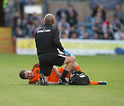 August 9th 2017, Dens Park, Dundee, Scotland; Scottish League Cup Second Round; Dundee versus Dundee United; Dundee United's Thomas Scobbie in agony with an injury to his groin