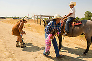 Henry Real Bird, daughter Lucy Real Bird, grandchildren, Crow Fair, Montana, horse