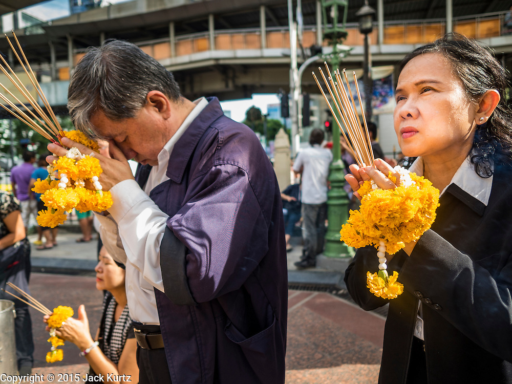 21 AUGUST 2015 - BANGKOK, THAILAND: People pray at Erawan Shrine Friday. The Bangkok Metropolitan Administration (BMA) held a religious ceremony Friday for the Ratchaprasong bomb victims. The ceremony started with a Brahmin blessing at Erawan Shrine, which was the target of a bombing Monday night. After the blessing people went across the street to the plaza in front of Central World mall for an interfaith religious service. Theravada Buddhists, Mahayana Buddhists, Muslims, Sikhs, Hindus, and Christians participated in the service. Life at the shrine, one of the busiest in Bangkok, is returning to normal. Friday the dancers and musicians who perform at the shrine resumed their schedules.       PHOTO BY JACK KURTZ