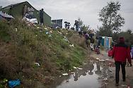 Calais, Pas-de-Calais, France - 24.10.2016    <br />  <br /> Start of the eviction on the so called &rdquo;Jungle&quot; refugee camp on the outskirts of the French city of Calais. Refugees and migrants leaving the camp to get with buses to asylum facilities in the entire country. Many thousands of migrants and refugees are waiting in some cases for years in the port city in the hope of being able to cross the English Channel to Britain. French authorities announced a week ago that they will evict the camp where currently up to up to 10,000 people live.<br /> <br /> <br /> Beginn der Raeumung des so genannte &rdquo;Jungle&rdquo;-Fluechtlingscamp in der franz&ouml;sischen Hafenstadt Calais. Fluechtlinge und Migranten verlassen das Camp um mit Bussen zu unterschiedlichen Asyleinrichtungen gebracht zu werden. Viele tausend Migranten und Fluechtlinge harren teilweise seit Jahren in der Hafenstadt aus in der Hoffnung den Aermelkanal nach Gro&szlig;britannien ueberqueren zu koennen. Die franzoesischen Behoerden kuendigten vor einigen Wochen an, dass sie das Camp, indem derzeit bis zu bis zu 10.000 Menschen leben raeumen werden. <br /> <br /> Photo: Bjoern Kietzmann
