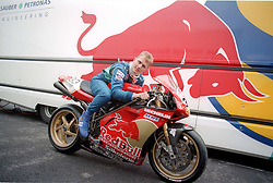 JOHNNY HERBERT GB RED BULL SAUBER TRYS OUT THE RED BULL DUCATI Motor Bike During Testing,  F1 Formula One Test British Grand Prix Silverstone 2nd July 1997