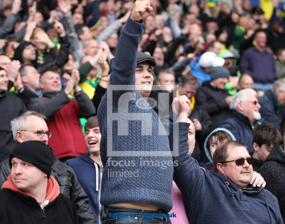 The traveling Norwich fans celebrate their side's winning goal during the Sky Bet Championship match at the Macron Stadium, Bolton<br /> Picture by Paul Chesterton/Focus Images Ltd +44 7904 640267<br /> 11/04/2015