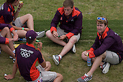 Volunteers rest between canoe slalom heats at the Lee Valley White Water Centre, north east London, on day 3 of the London 2012 Olympic Games. London 2012 volunteers are called 'Games Makers', as they are helping to make the Games happen. Up to 70,000 Games Makers take on a wide variety of roles across the venues: from welcoming visitors; to transporting athletes; to helping out behind the scenes in the Technology team to make sure the results get displayed as quickly and accurately as possible. Games Makers come from a diverse range of communities and backgrounds, from across the UK and abroad. The vast majority are giving up at least 10 days to volunteer during the Games.