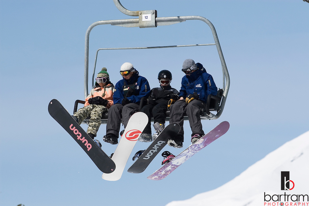 Snowboarders ride a lift at Mt. Bachelor, near Bend, Oregon.