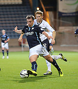 Dundee's Paul McGowan races away from Raith Rovers' Jason Thomson - Dundee v Raith Rovers, Scottish League Cup at Dens Park<br /> <br />  - &copy; David Young - www.davidyoungphoto.co.uk - email: davidyoungphoto@gmail.com