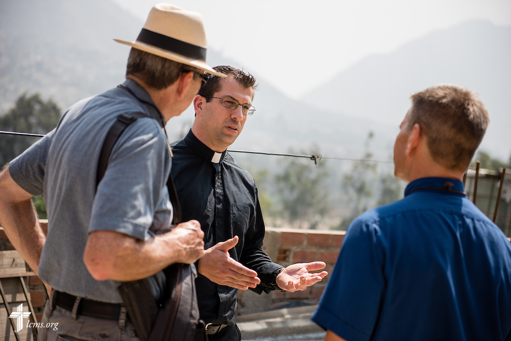 The Rev. Ross Johnson, LCMS director of Disaster Response, talks to the Rev. Herb Burch (left) and the Rev. Mark Eisold (right), both LCMS career missionaries to Peru, at the Noe school (Spanish for Noah) near Lima, Peru, on Tuesday, April 7, 2015. LCMS Communications/Erik M. Lunsford