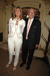LORD & LADY CHETWODE at a reception to celebrate the launch of Prince Dimitri of Yugoslavia's one-of-a-kind jeweleery collection held at Partridge Fine Art, 144-146 New Bond Street, London on 11th June 2008.<br />