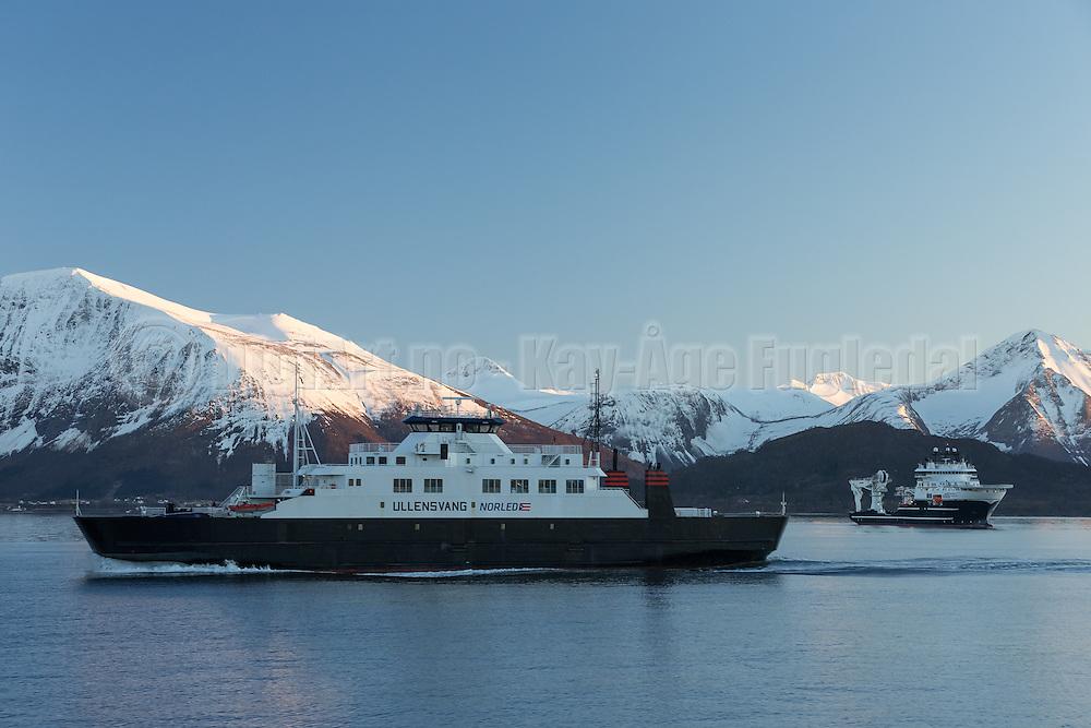 Ferry sailing in Norwegian fjord, with snowy mountains in the background | Ferga Ullensvang seiler i Sulafjorden på Vestlandet, med snøkledde fjell og offshore fartøyet Grand Canyon II i bakgrunnen.