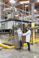 Man working on machinery in bottling industry