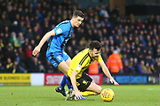 Burton Albion midfielder Scott Fraser (7) is tackled by Gillingham FC midfielder Callum Reilly (13) during the EFL Sky Bet League 1 match between Burton Albion and Gillingham at the Pirelli Stadium, Burton upon Trent, England on 12 January 2019.
