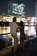 """A couple enjoys the above-deck views of the Odaiba district from one of Harumiya Co.'s """"yakata-bune"""" pleasure boats in Tokyo Bay, Japan on 31 August  2010. Photographer: Robert Gilhooly"""