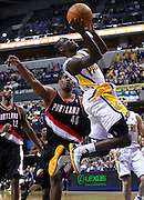 March 13, 2012; Indianapolis, IN, USA; Indiana Pacers point guard Darren Collison (2) shoots the ball as Portland Trail Blazers center Kurt Thomas (40)  defends at Bankers Life Fieldhouse. Indiana defeated Portland 92-75. Mandatory credit: Michael Hickey-US PRESSWIRE