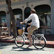 Bicycling on State street.Santa Barbara,CA.
