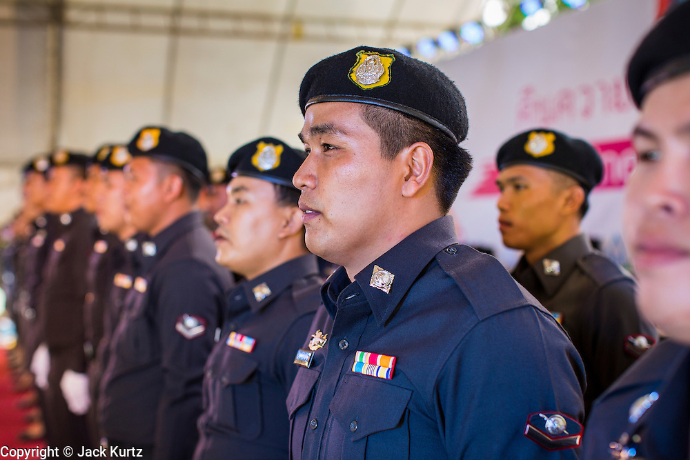 "15 JUNE 2014 - BANGKOK, THAILAND: A Thai police choir performs on a stage during a ""Return Happiness to Thais"" party in Lumpini Park in Bangkok. The Thai military junta, formally called the National Council for Peace and Order (NCPO), is sponsoring a series of events throughout Thailand to restore ""Happiness to Thais."" The events feature live music, dancing girls, military and police choirs, health screenings and free food.   PHOTO BY JACK KURTZ"