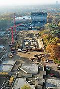 Nederland, Nijmegen, 16-11-2018Gebouwen van de Radboud Universteit, RU, RUN . De Thomas van Aquinostraat is gesloopt en er worden nieuwe gebouwen neergezet . Op de achtergrond het spinozagebouw van psychologie .Foto: Flip Franssen
