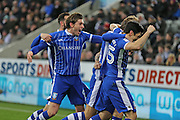 Sheffield Wednesday captain Glenn Loovens (12) scores and celebrates his goal with team mates 0-1 second half  during the EFL Sky Bet Championship match between Newcastle United and Sheffield Wednesday at St. James's Park, Newcastle, England on 26 December 2016. Photo by Gary Learmonth.