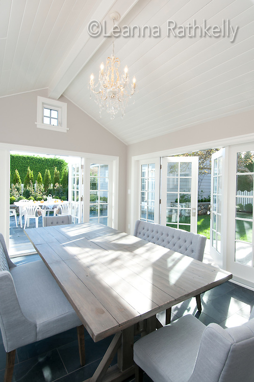 A home built in the 1930s in Victoria, BC, is renovated to include a new dining room with double french doors that open onto a backyard patio.