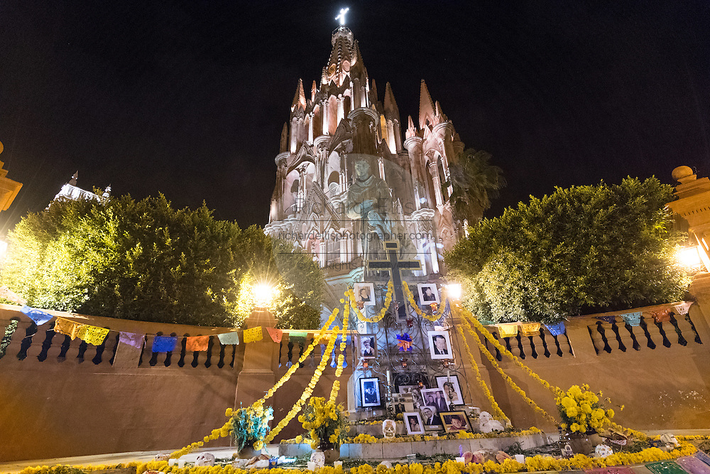 The Statue of Fray Juan de San Miguel in front of the Parroquia de San Miguel Arcangel church decorated during the Day of the Dead festival November 1, 2016 in San Miguel de Allende, Guanajuato, Mexico. The week-long celebration is a time when Mexicans welcome the dead back to earth for a visit and celebrate life.