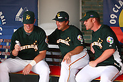 MEXICO CITY - MARCH 11: (L-R) Catcher Andrew Graham #9, first base coach Pat Kelly, and pitcher Damian Moss #28 of the Australia team share some laughs before taking on Mexico in the Pool B, game 5 in the first round of the 2009 World Baseball Classic at Foro Sol Stadium in Mexico City, Mexico on Wednesday March 11, 2009. Mexico defeated Australia by mercy rule 16-1. (Photo by Paul Spinelli/WBCI/MLB Photos) *** Local Caption *** Andrew Graham;Pat Kelly;Damian Moss