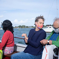People in a small boat wearing facemasks against Covid19 infection