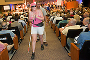 Aug 26, 2009 -- PHOENIX, AZ: MARIE RAMIREZ is escorted out of Sen John McCain's town hall meeting on health care reform by Phoenix police after she tried to shout at Sen McCain in North Phoenix Baptist Church in Phoenix, AZ, Wednesday. Sen McCain hosted his second town hall meeting on health care in two days Wednesday. About 1,000 people attended the meeting. Although most were opposed to President Obama's health care proposals and supported Sen McCain, there was a large group who support the President's health care efforts.  Photo by Jack Kurtz