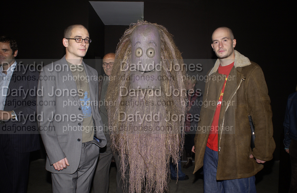 Dinos and Jake Chapman at their opening, Jake and Dinos Chapman. White Cube. 30 October 2002. © Copyright Photograph by Dafydd Jones 66 Stockwell Park Rd. London SW9 0DA Tel 020 7733 0108 www.dafjones.com