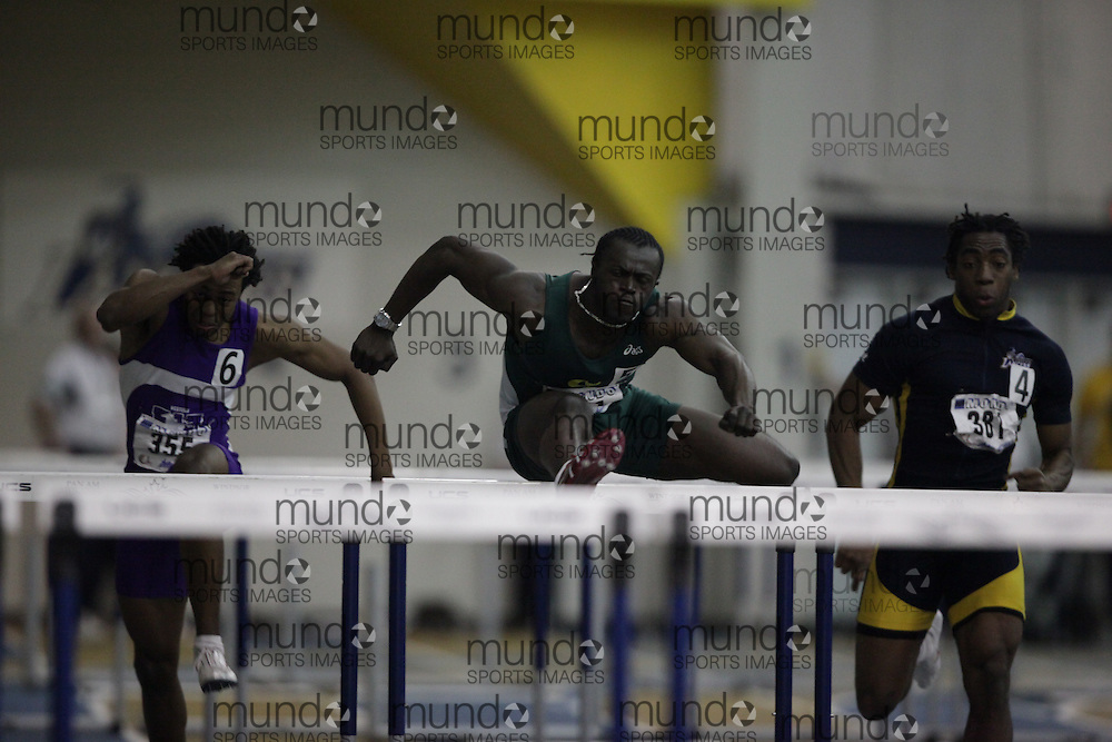 Windsor, Ontario ---13/03/09--- Valery Komenan of  Universite de Sherbrooke competes in the 60 meter hurdle prelims at the CIS track and field championships in Windsor, Ontario, March 13, 2009..GEOFF ROBINS Mundo Sport Images