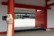 tourist taking picture at the Kyoto Imperial Palace grounds Japan