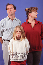 Portrait of estranged couple and young girl,
