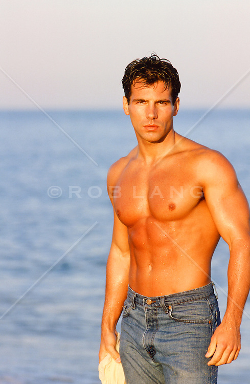 portrait of a handsome man at the beach