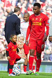 LIVERPOOL, ENGLAND - Sunday, May 11, 2014: Liverpool's Daniel Sturridge and young child after the Premiership match at Anfield. (Pic by David Rawcliffe/Propaganda)