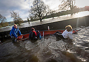 31-12-15<br /> The Tanaiste Joan Burton (right) pictured as a boat capsized on the Quays in Thomastown Co. Kilkenny with Ann Phelan TD Minister of State at the Departments of Agriculture, Food and Marine and Transport, Tourism and Sport with Special Responsibility for Rural Economic Development (implementation of the CEDRA Report) and rural transport while being taken to Shem Caulfeilds flooded house.<br /> Shem is pulling the boat<br /> <br /> Picture Dylan Vaughan.