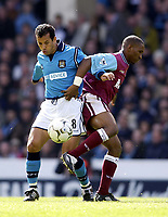 Manchester City v West Ham United, FA Barclaycard Premiership, Maine Road, Manchester. 27/04/2003.<br />West Ham's Jermaine Defoe (R) tries to wrestle possession away from Man City's Ali Benarbia.<br />Photo: Jed Wee, Digitalsport