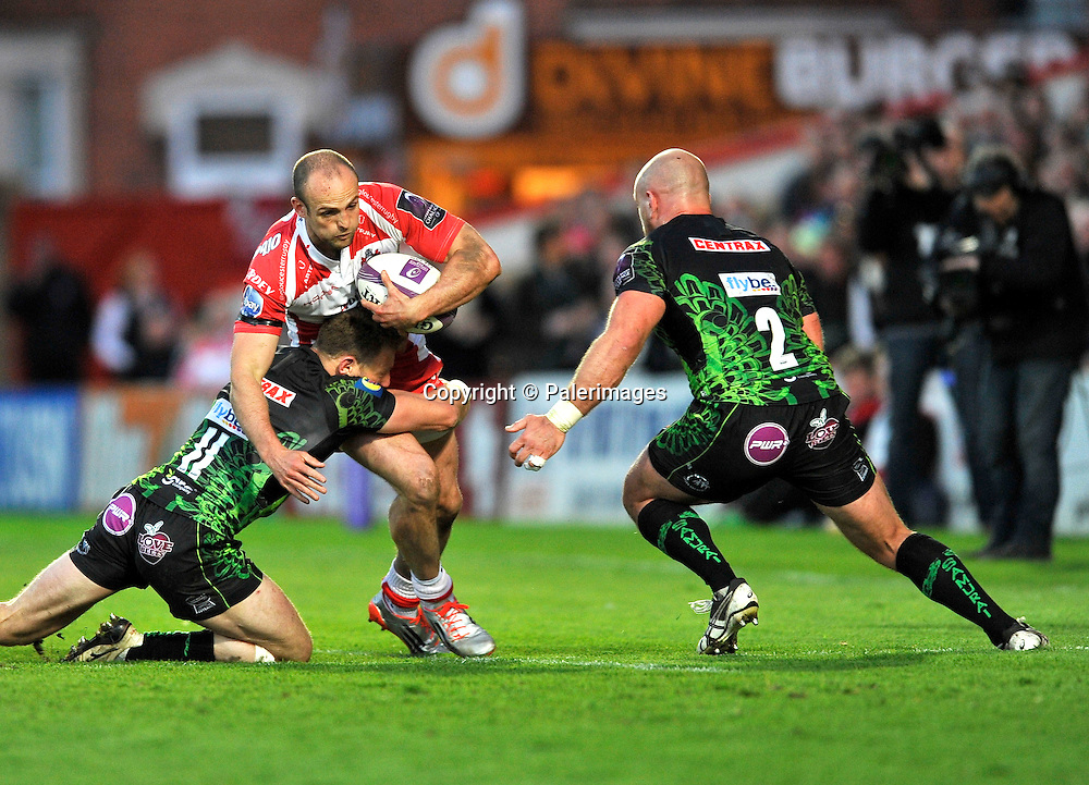Gloucester, England.  Charlie Sharples of Gloucester Rugby tackled by Matt Jess of Exeter Chiefs during the European Rugby Challenge Cup semi-final match between Gloucester Rugby vs Exeter Chiefs at Kingsholm Stadium on April 18, 2015 in Gloucester, England. Photo Michael Paler/ Photosport.co.nz