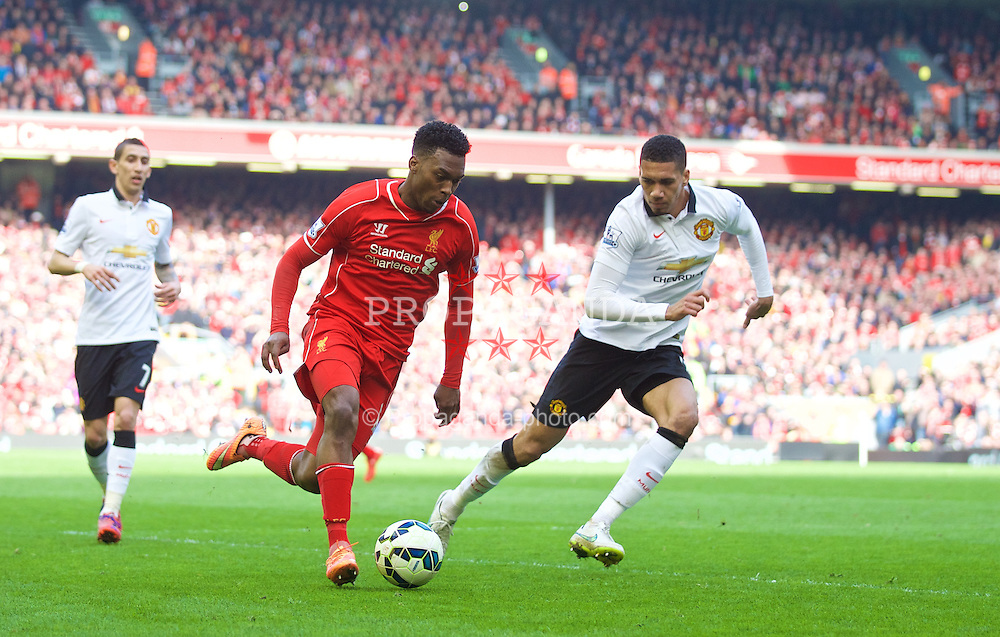 LIVERPOOL, ENGLAND - Sunday, March 22, 2015: Liverpool's Daniel Sturridge in action against Manchester United's Chris Smalling during the Premier League match at Anfield. (Pic by David Rawcliffe/Propaganda)