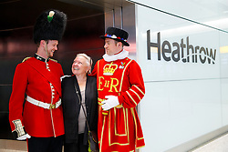 © Licensed to London News Pictures. 04/06/2014. LONDON, UK. Entertainers welcoming passengers arriving to London Heathrow's new Terminal 2 on Wednesday, 4 June 2014. The new terminal has 60 check-in gates and 66 self-check-in kiosks, 29 security lanes, 33 shops and 17 restaurants. On the first day of operation, airport welcomed 34 United flights for the US. Photo credit : Tolga Akmen/LNP