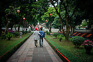 Vietnam, Hanoi. Young couple in The Temple of Literature - the most beautiful temple in the capital of Vietnam.