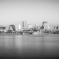 Peoria skyline black and white photo of Peoria downtown city buildings along the Illinois River waterfront and the Spirit of Peoria riverboat.
